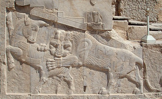 Bas-relief in Persepolis. A Zoroastrian symbol of Nowruz - on the vernal equinox the powers of the eternally fighting bull (personifying the Earth) and lion (personifying the Sun) are equal.